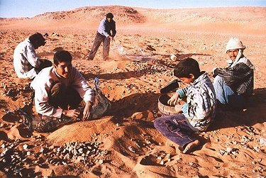Group of nomads screening and digging for NWA 1110 Martian meteorite fragments.
