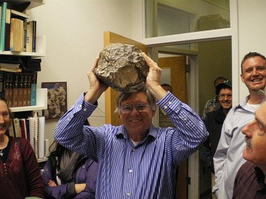 Dr. Don Brownlee of NASA Stardust Mission fame holding Northwest Africa 5000 in triumph over his head.
